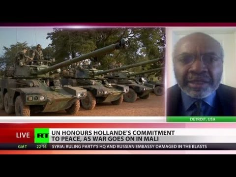 Prize for Killing? UN honors Hollande for peace as war goes on in Mali