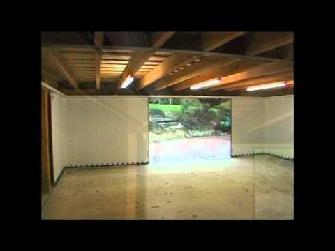 sliding garage doorThe Vertico sliding garage door  YouTube