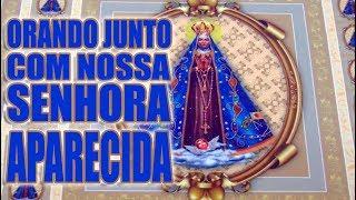Orando junto com Nossa Senhora Aparecida