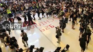 Hong Kong: Demonstrators desecrate China's flag at shopping mall protest