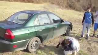 Crazy guy trying to break car window with his head - funny!