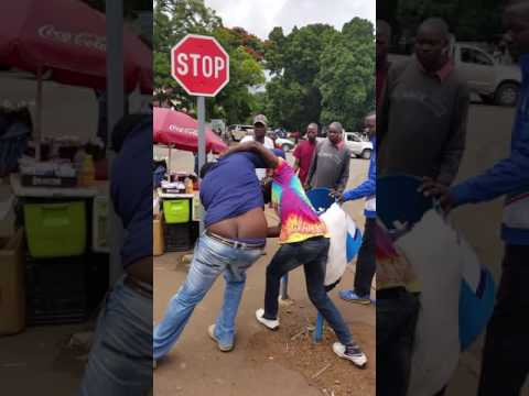 Men fighting for US $0.10 or 10 cents in Harare CBD