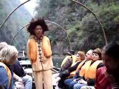 Chinese Guide Singing on a Riverboat on Yangtze River