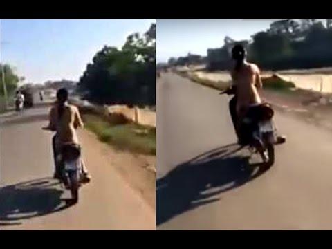 Tin tức trong ngày – Sự thật xót xa về cô gái khỏa thân lái xe máy