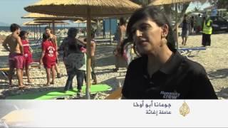دروس لتعليم السباحة لأطفال اللاجئين باليونان