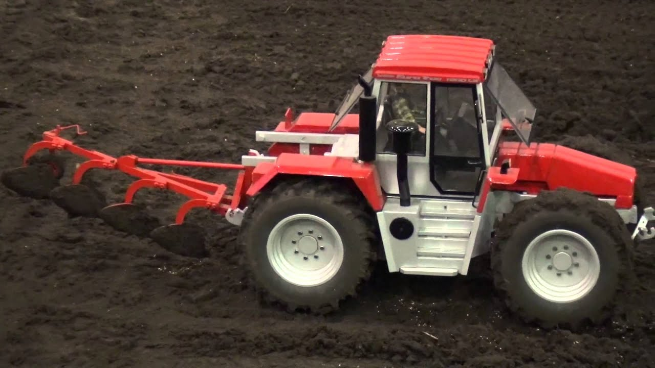 RC Tractors Plowing A Field