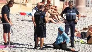 الشرطة تجبر مسلمة على خلع ملابسها البوركيني بشاطئ نيس بفرنسا