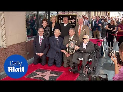 Michael Douglas receives star with his father Kirk by his side