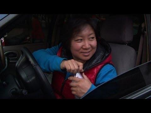 Chinese women shrug off Beijing police driving tips
