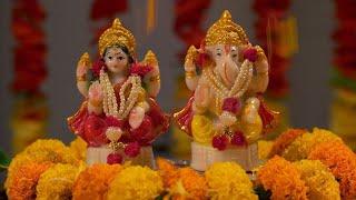 Diwali Puja - Flower showering on the idols of Goddess Lakshmi and Ganesha