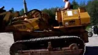 Unloading Komatsu D41S track loader
