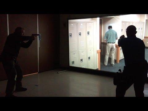 Worcester police officers demonstrate MILO Range training simulator