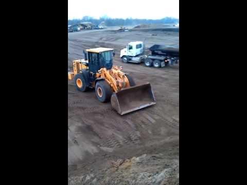 Stockpiling sand and gravel.