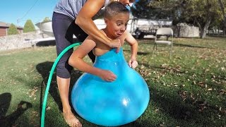 One of Carl & Jinger Family's most viewed videos: FITTING INSIDE A GIANT WATER BALLOON!!