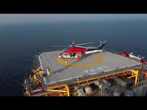 Chopper Landing on Drilling Rig