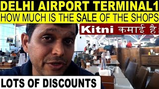 How much does the shops earn in New Delhi AIRPORT Terminal1 in hindi