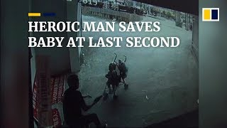 Heroic man saves baby at last second