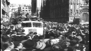 A large number of people cheer as partisans move past them and Fascists open fire...HD Stock Footage