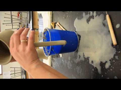 Pulling a handle off a mug. Ceramics 1. Ms. Greninger. NCS, PFAA.