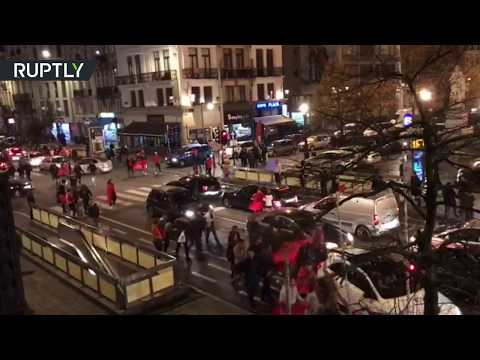 At least 22 policemen injured as football fans become violent in Brussels