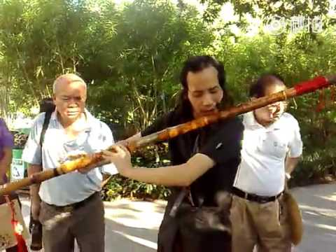 Chinese street performer plays song on what could be world's largest flute
