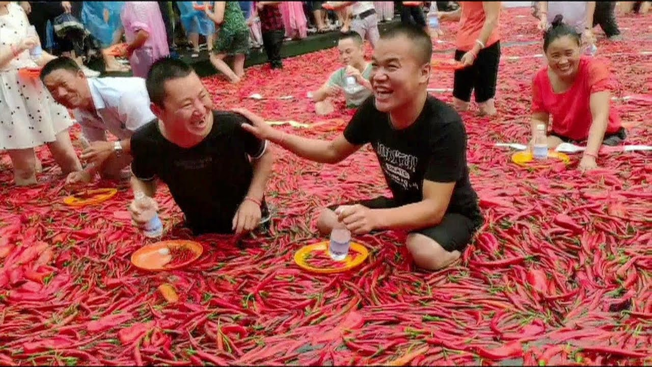 Chinese on fire at chili-eating festival - YouTube