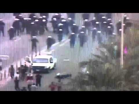Rioters drive over police in bahrain 13_3_2011
