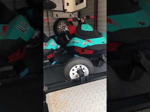 Ryobi 18v air compressor in action on trailer tire