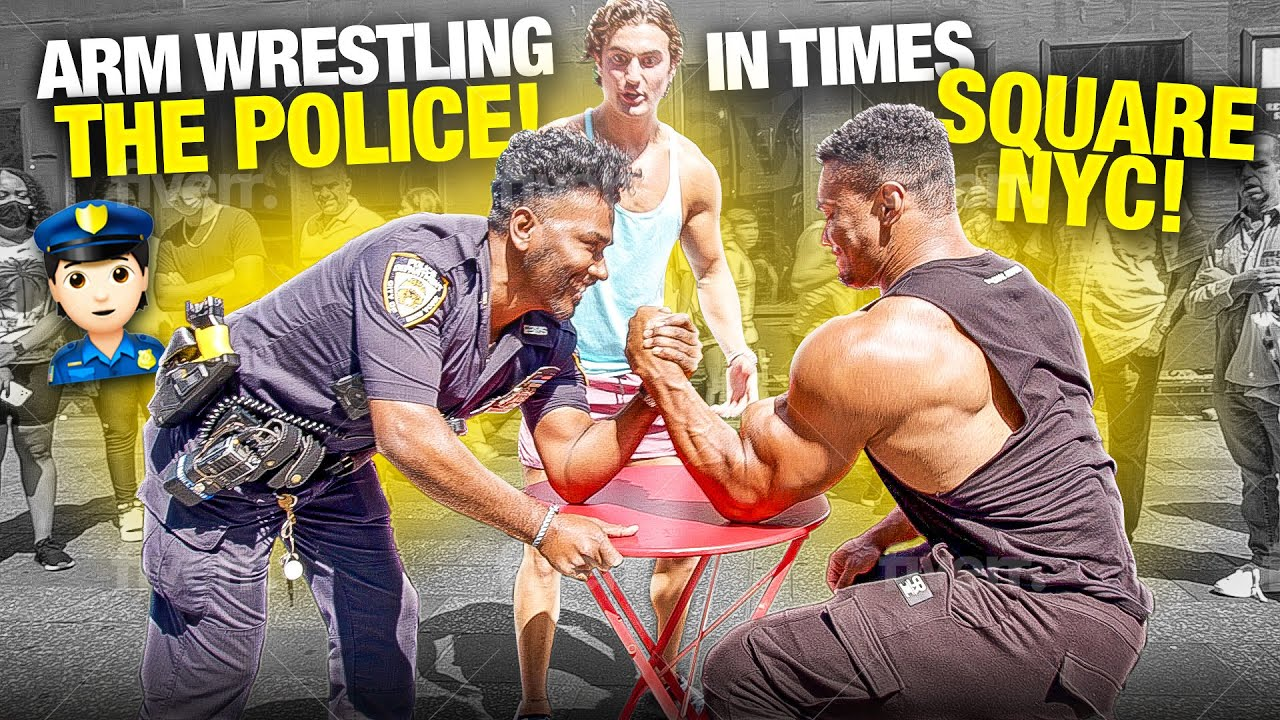 ARM WRESTLING TOURISTS AND POLICE OFFICERS IN TIMES SQUARE NEW YORK CITY!