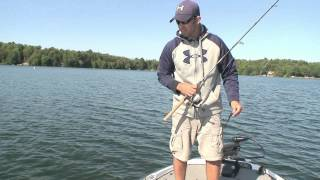 Bass Pulls Rod Off of Boat - Angler Gets Rod Back & Fish
