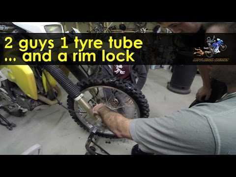 3 guys 1 tyre tube and a rim lock