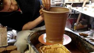 Throwing making a Terracotta Clay Long Tom Flower / Plant Pot on the Wheel