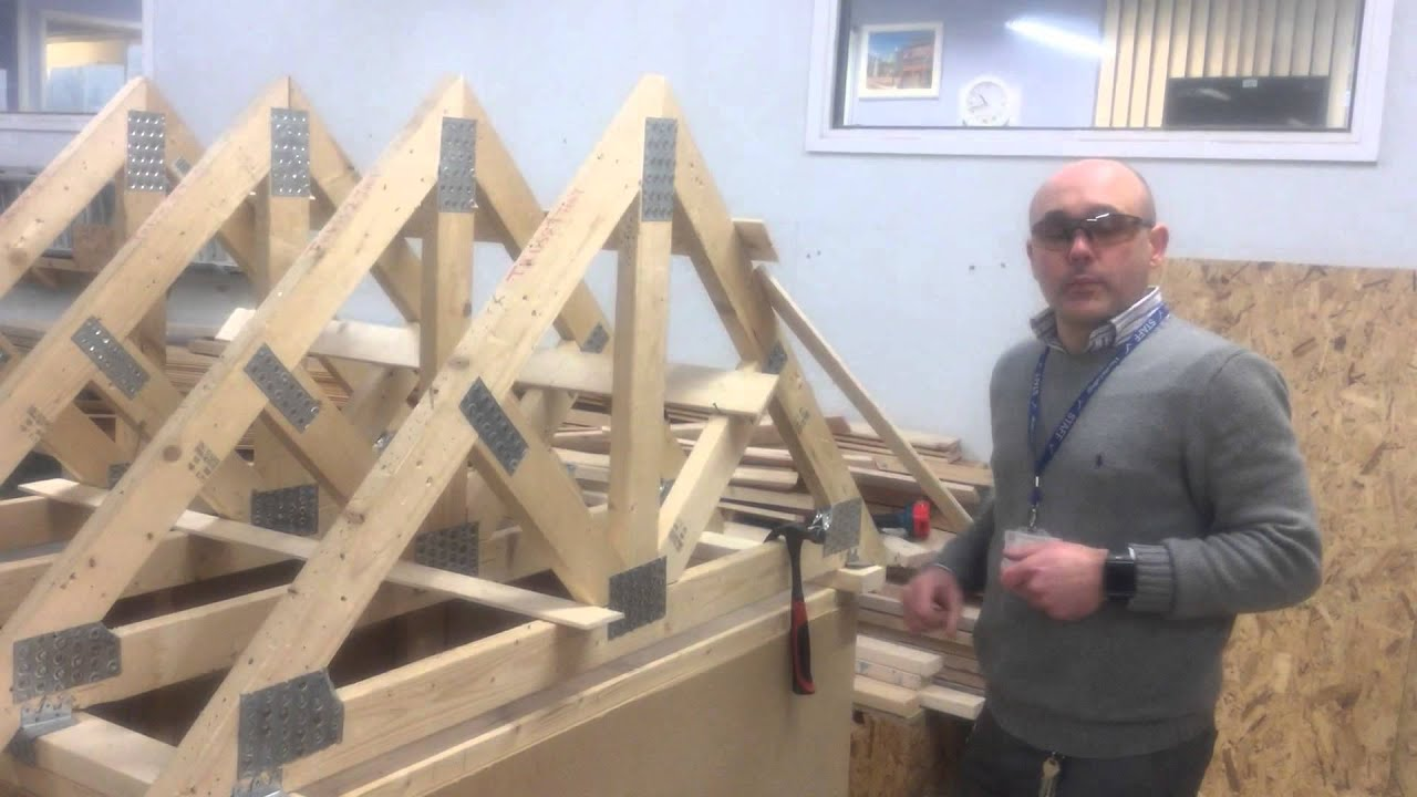 Erecting a roof part 2 installing the trusses youtube for Roof trusses installation