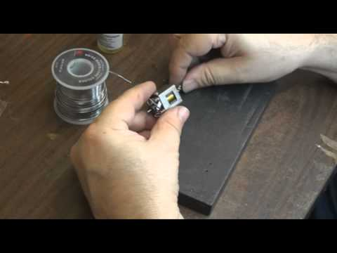 Soldering on a spin proof pinion by Mick A. of Slot Car City