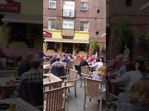 Alan Millington sings at Thomas Rigbys pub in Liverpool