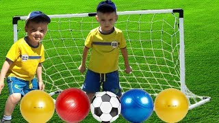 Kids play football with colorful balls for children
