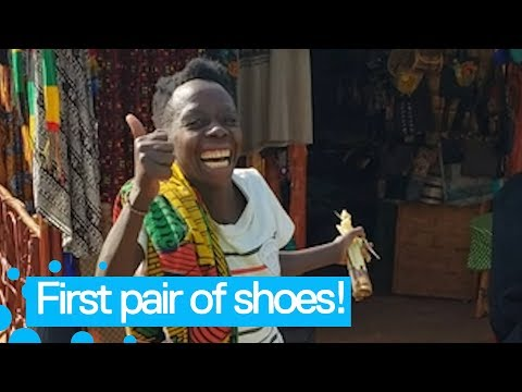 Ugandan woman receives her first pair of shoes [AMAZING REACTION!]