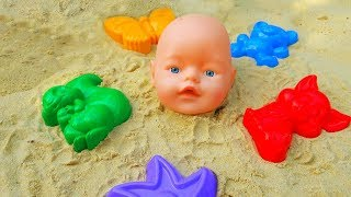 vuclip Learn Colors with Baby Born Doll & Sand Molds video for kids