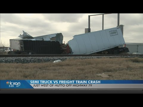 Semi-truck and freight train collide in Hutto
