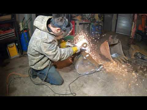 Installing a quick change coupler on an excavator