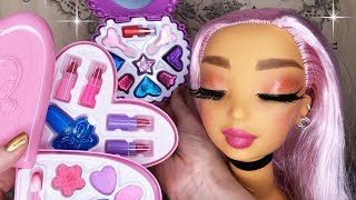 ASMR whispered video applying children's makeup to a doll head. Lot...