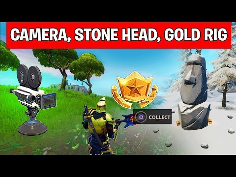 SEARCH BETWEEN A BASEMENT FILM CAMERA, A SNOWY STONE HEAD AND A FLASHY GOLD BIG RIG Fortnite Guide
