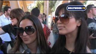 Kim Kardashian and Adrienne Bailon at the Janeen Mansour Celebrity Shoe Drive