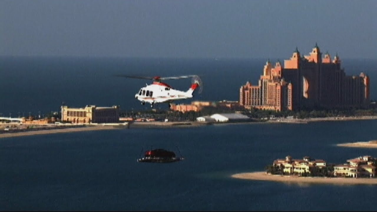 Aston Martin Flying Car Stunt In Dubai Youtube