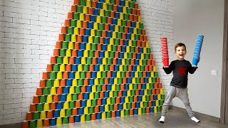 Giant pyramid of colored cups. Video for kids.