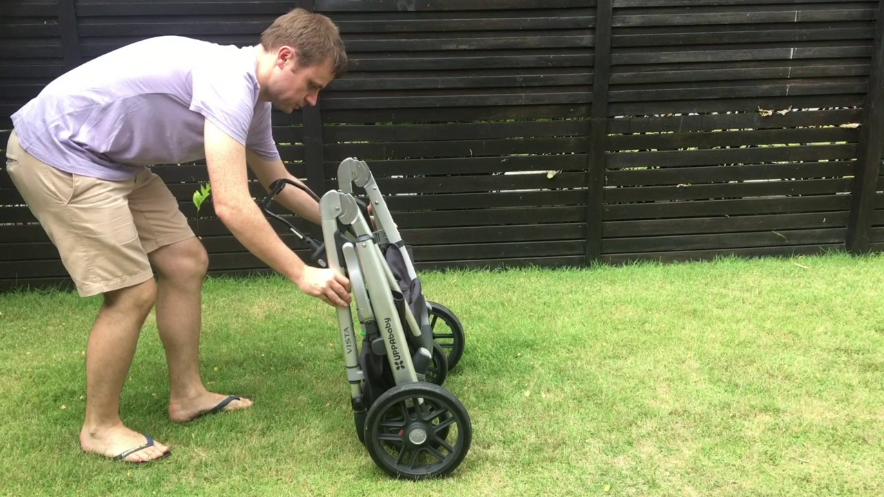 Folding the UPPAbaby Vista with the frame-style car seat adapter ...