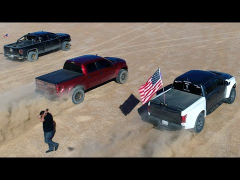 GMC Sierra vs Ford Raptors drag race removing traction control 2016