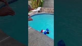 Elijah swimming in the pool