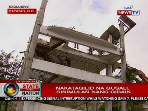 Nakatagilid na gusali sa Payatas, Quezon City, sinimulan nang gibain