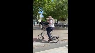 Man Cycling Out With His Cat On His Shoulder